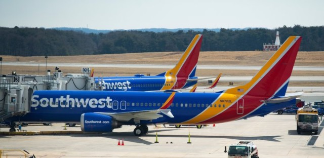 "A Boeing 737 Max 8 flown by Southwest Airlines sits at the gate at Baltimore Washington International Airport on Wednesday. ""The grounding will remain in effect pending further investigation, including examination of information from the aircraft's flight data recorders and cockpit voice recorders,"" the FAA said in a statement."