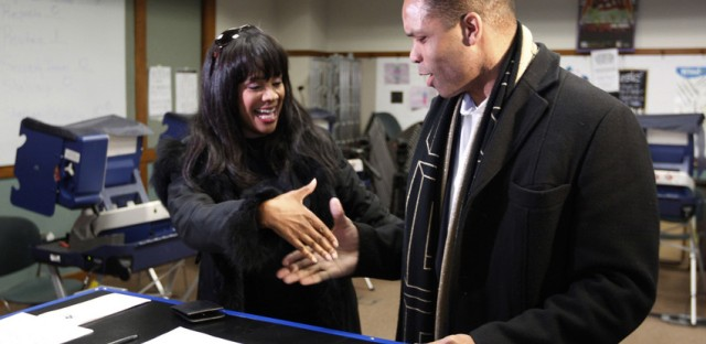U.S. Rep. Jesse Jackson Jr. and his wife, Chicago Alderman Sandi Jackson, asked each other for their support and votes as they arrived at a polling station for early voting in March of this year.