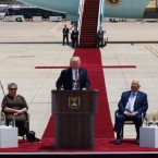 President Donald Trump gives a speech as Israeli Prime Minister Benjamin Netanyahu (right), Israeli President Reuven Rivlin and his wife Nehama, first lady Melania Trump and the prime minister's wife Sara Netanyahu (left) listen during a welcome ceremony at Ben Gurion International Airport in Tel Aviv on Monday.