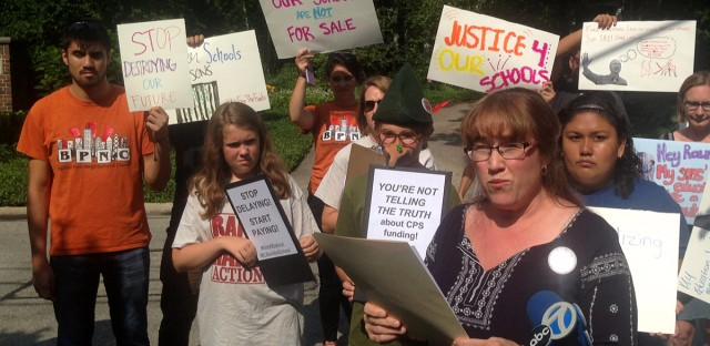Protestors from Chicago traveled to Gov. Bruce Rauner's Winnetka neighborhood to speak out against the governor's partial veto of a bill that would change the way the state funds public schools.