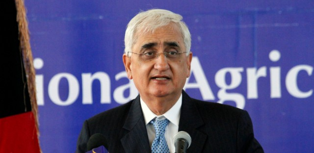 Indian Foreign Minister Salman Khurshid speaks at the inauguration ceremony of the Afghan National Agriculture Science and Technology University accompanied by Afghan President Hamid Karzai, in Kandahar province south of Kabul, Afghanistan, Saturday, Feb. 15, 2014. A total 4.5 million U.S. dollars has been spent by the government of India in building the university.