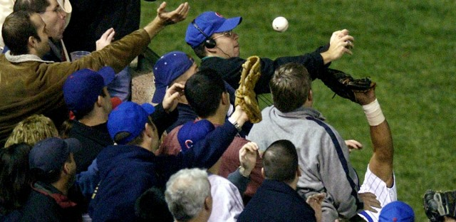 Steve Bartman, top center, catches a ball as Chicago Cubs left fielder Moises Alou's arm is seen reaching into the stands against the Florida Marlins in the eighth inning of Game 6 of the National League championship series on Oct. 14, 2003, at Wrigley Field in Chicago.