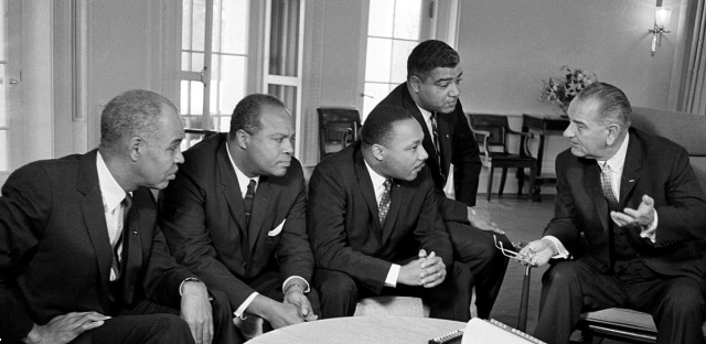 President Lyndon B. Johnson, right, talks with Dr. Martin Luther King Jr. and other civil rights leaders in his White House office in Washington, D.C., Jan. 18, 1964.