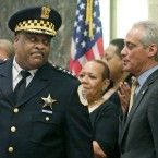 In this April 13, 2016 photo, Chicago Police Superintendent Eddie Johnson speaks with Mayor Rahm Emanuel at Johnson's swearing-in ceremony in Chicago.