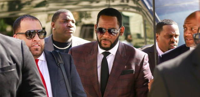 In this June 26, 2019, file photo, R&B singer R. Kelly, center, arrives at the Leighton Criminal Court building for an arraignment on sex-related felonies in Chicago. Kelly did not appear in court Thursday, Aug. 15.