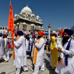 Sikh pilgrims march during the Vasakhi festival, at the shrine of Gurdwara Punja Sahib, the second most sacred place for Sikhs, near Islamabad, Pakistan, Saturday, April 14, 2018.