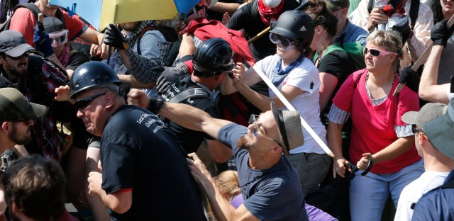 White nationalist demonstrators clash with counter demonstrators at the entrance to Lee Park in Charlottesville, Va., on Saturday.