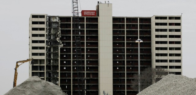 A large crane stands in place as demolition begins at the last high-rise at Chicago's Cabrini-Green public housing complex, Wednesday, March 30, 2011, in Chicago. Cabrini-Green was built on Chicago's North Side starting in the 1940s. (AP Photo/M. Spencer Green)