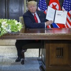 U.S. President Donald Trump holds up a document he and North Korean leader Kim Jong Un signed at the US North Korea summit in Singapore.