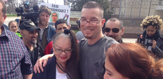 Roberto Almodovar hugs his mother, Angela Navarro, after being released from prison. Cook County State's Attorney Kim Foxx dismissed double-murder charges against him and an accomplice on Friday.