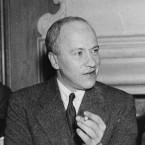 New York Times correspondent Walter Duranty chats during an Association of Foreign Correspondents luncheon honoring him on April 16, 1936 in New York.