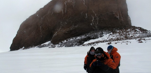 Tourists near Castle Rock on Crater Hill on Ross Island, Antarctica on Jan. 20, 2013.