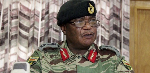 """Zimbabwe's Army chief, Gen. Constantino Chiwenga, threatened at a Monday news conference in the capital to """"step in"""" to calm political tensions over the president's firing of his deputy."""
