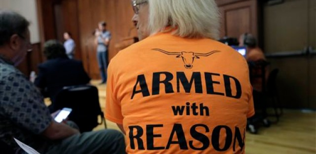 In this Wednesday, Sept. 30, 2015, file photo, professor Ann Cvetkovich waits to speak during a public forum as a special committee studies how to implement a new law allowing students with concealed weapons permits to carry firearms into class and other campus buildings, which will take effect in August 2016, in Austin, Texas. Despite a federal law requiring them to have detailed emergency plans, colleges across the country vary widely in how they prepare for campus shootings and inform their staffs and students.