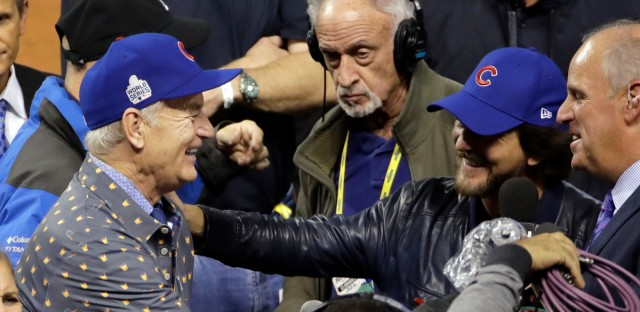 Bill Murray and Eddie Vedder celebrate after Game 7 of the Major League Baseball World Series between the Cleveland Indians and the Chicago Cubs Thursday, Nov. 3, 2016, in Cleveland. The Cubs won 8-7 in 10 innings to win the series 4-3.