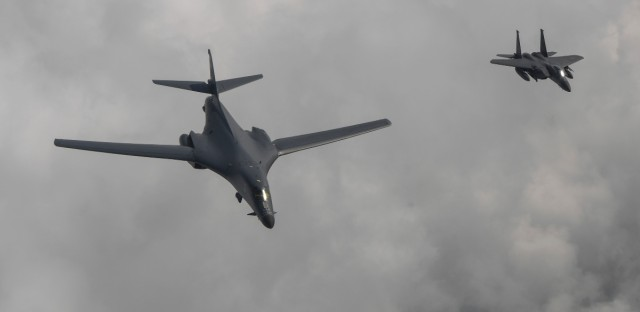 In this photo provided by South Korea Defense Ministry, a U.S. Air Force B-1B bomber, left, flies with a South Korean fighter jet F-15K over the Korean Peninsula, South Korea, Sunday, July 30, 2017. The United States flew two supersonic bombers over the Korean Peninsula on Sunday in a show of force against North Korea following the country's latest intercontinental ballistic missile test.