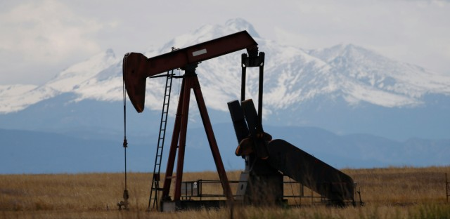 In this May 27, 2016, file photo, a pump jack works near Firestone, Colo. The Colorado Supreme Court is considering a high-stakes lawsuit over how much weight the state should give public health and the environment when regulating the oil and gas industry.