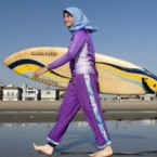 """Sama Wareh wears an example of swimwear designed for Muslim women. City ordinances in Cannes effectively forbade the burkini as well as swimwear that """"ostentatiously displays religious affiliation, when France and places of worship are currently the target of terrorist attacks."""""""