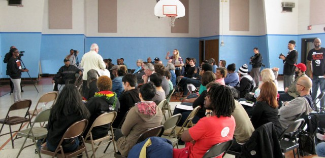 Activists gather at a school next door to the Greater St. Mark Family Church in Ferguson, Mo. for a meeting of what the Organization for Black Struggle was calling a 'People's Movement Assembly.'