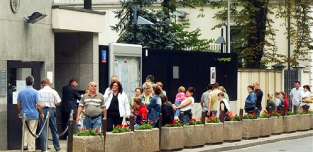 Poles lining up outside the Visa Section of the U.S. Embassy in Warsaw, Poland. The country's supporters in the U.S. are pushing for easier travel access as part of the immigration reform bill.