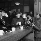 """American servicemen enjoy a hot cup of coffee at a Salvation Army hut in New York, circa 1918. During World War I, instant coffee was a key provision for soldiers on the front. They called it a """"cup of George."""""""