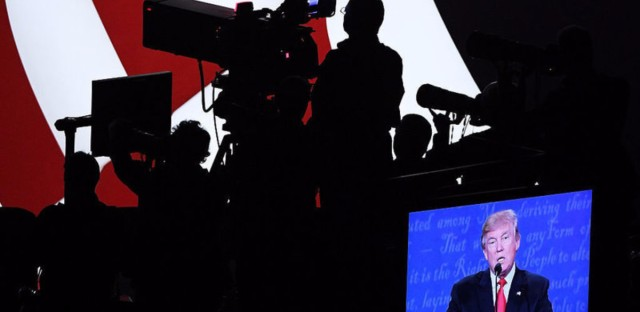 Republican presidential nominee Donald Trump is projected on a screen as he speaks Wednesday night in Las Vegas during the third presidential debate. The Trump campaign streamed the event live and produced post-debate coverage on its Facebook page.