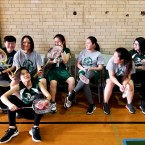 Kelly High School's new girls varsity badminton team waits for their games to begin at their Southwest Side Chicago public school. When flyers went up looking for players, a group of Asian immigrants rushed to play a sport that is hugely popular in China.