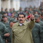 In this handout photo released by the Miraflores Presidential Press Office, Venezuela's President Nicolas Maduro flashes a V for Victory hand gesture after arriving at the Fort Tiuna military base in Caracas, Venezuela, Wednesday, Jan. 30, 2019. Since opposition leader Juan Guaido declared himself interim president last week with the support of the U.S. and other nations, Maduro has appeared almost daily on state TV with his military, projecting an image of invincibility even as international pressure against him builds.
