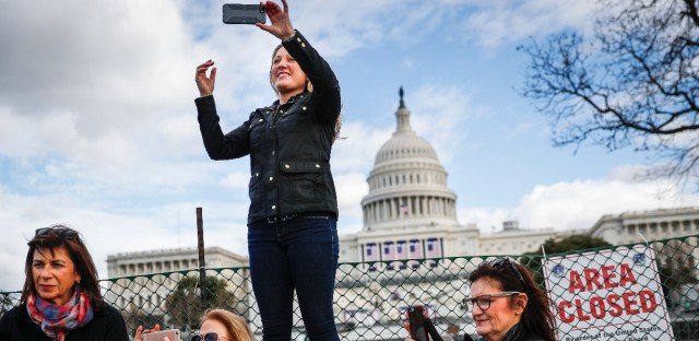 Micaela Johnson, of Leewood, Kan., in town to take part in Saturday's Women's March on Washington, takes a selfie with the Capitol Building in the background as preparations continue for Friday's presidential inauguration, Wednesday, Jan. 18, 2017, in Washington.