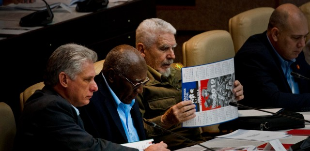 Cuba's President Miguel Diaz-Canel, left, Cuban First Vice President Salvador Valdes Mesa, second left, and Cuban Vice President Ramiro Valdez, center, attend the session to debate the draft of a new Constitution, at the Convention Palace in Havana, Cuba, Friday, Dec. 21, 2018. Cuba's government removed language promoting the legalization of gay marriage from the draft after widespread popular rejection of the idea.
