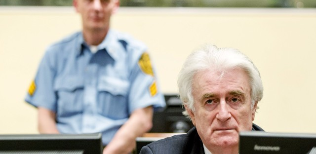 Bosnian Serb wartime leader Radovan Karadzic sits in the courtroom for the reading of his verdict Thursday in The Hague.