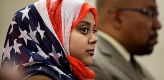 Faateha Syed listens to a roundtable discussion on religious freedom with the regional interfaith community at All Dulles Area Muslim Society (ADAMS) Mosque in Sterling, Va., Thursday, July 21, 2016, attended by Sen. Tim Kaine, D-Va. Syed is also a member of the Girl Scouts of America. (AP Photo/Manuel Balce Ceneta)