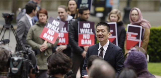 Hawaii Attorney General Doug Chin speaks to media outside the 9th Circuit U.S. Court of Appeals in Seattle, Washington, on May 15, 2017. The court has largely upheld a preliminary injunction blocking President Trump's travel ban from going into effect.