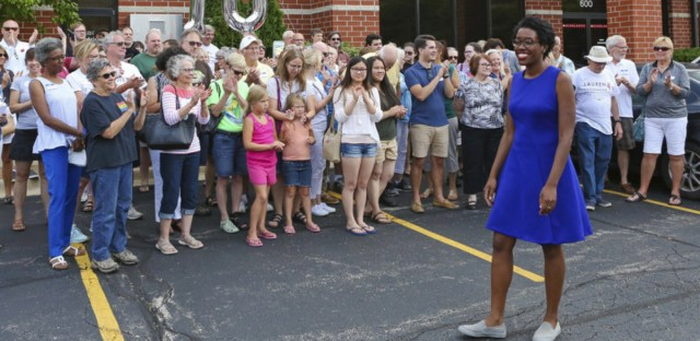 In this July 29, 2018, photo, rookie Democratic candidate Lauren Underwood greets supporters at the opening of her campaign office in St. Charles, Ill., 100 days before the midterm election. Teresa Crawford/AP