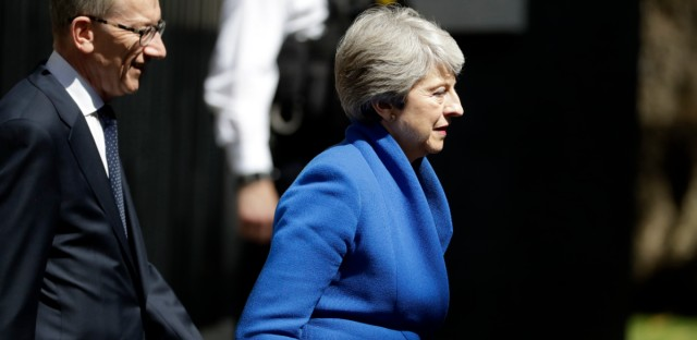 Britain's Prime Minister Theresa May leaves after delivering a speech outside 10 Downing Street, London before leaving for Buckingham Palace where she will hand her resignation to Queen Elizabeth II, Wednesday, July 24, 2019. Boris Johnson will replace May as Prime Minister later Wednesday, following her resignation last month after Parliament repeatedly rejected the Brexit withdrawal agreement she struck with the European Union.