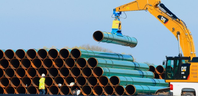 Pipes for the proposed Dakota Access Pipeline are stacked at a staging area in Worthing, S.D. on May 9, 2015.