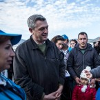 United Nations High Commissioner for Refugees Filippo Grandi?, left, speaks with a Syrian family at the port of Mytilene during his visit on the northeastern Greek island of Lesbos, Tuesday, Feb. 23, 2016. Nearly 100,000 migrants and refugees have traveled to Greek islands from nearby Turkey so far this year.