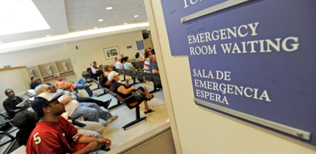Patients wait in the emergency room at Stroger Hospital of Cook County.