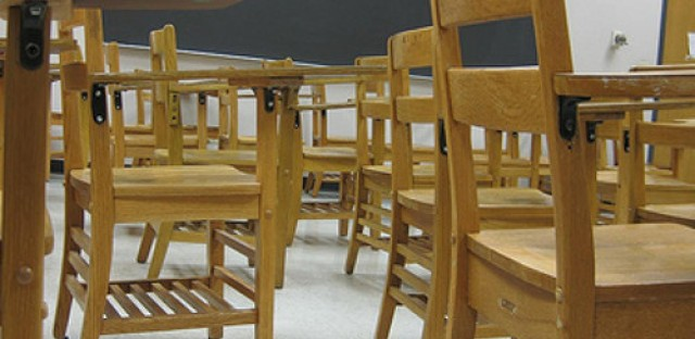 Local coalition claims school closings violate human rights