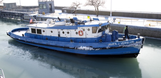 The James J. Versluis, a 90-foot icebreaking tug owned by Chicago's Water Department, can move through 18 inches of ice.
