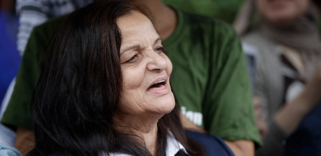 Palestinian activist Rasmea Odeh of Chicago, stands outside the Theodore Levin U.S. Courthouse in Detroit, Mich., for a final court hearing on Aug. 17, 2017.