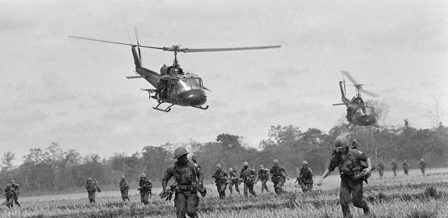 Troops of the U.S. 173rd Airborne Brigade run from a helicopter landing zone northwest of Bien Hoa, May 20, 1965. The paratroopers encountered sniper fire, but no direct contact with Communist guerrillas.