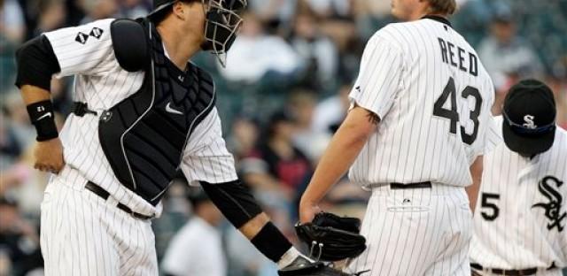 Sox catcher AJ Pierzynski talks to Addison Reed on the mound.