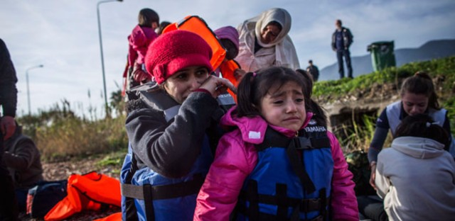 A Syrian refugee and her child cry after their arrival from Turkey on the southeastern island of Lesbos, Sunday, Feb. 28, 2016. Greece is mired in a full-blown diplomatic dispute with some EU countries over their border slowdowns and closures. Those border moves have left Greece and the migrants caught between an increasingly fractious Europe, where several countries are reluctant to accept more asylum-seekers, and Turkey, which has appeared unwilling or unable to staunch the torrent of people leaving in barely seaworthy smuggling boats for Greek islands.