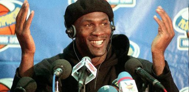 Chicago Bulls player Michael Jordan gestures during a news conference at Bercy stadium in Paris Wednesday Oct. 15, 1997. Michael Jordan is the richest athlete in the world, regaining the top spot on the Forbes magazine list for the fifth time in six years. Jordan will earn dlrs 78.3 million in 1997.