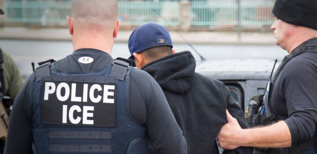 This Feb. 7, 2017 photo released by U.S. Immigration and Customs Enforcement shows foreign nationals being arrested during an operation conducted by ICE in Los Angeles. According to a new report, the Chicago Police Department's error-ridden gang database was searched 32,000 times by federal immigration agencies, including ICE, over the past two decades.
