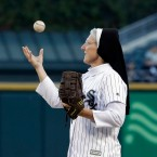 Sister Mary Jo Sobieck tosses the ball as she throws out a ceremonial first pitch before a baseball game between the Chicago Cubs and the Chicago White Sox on Saturday, Sept. 22, 2018.