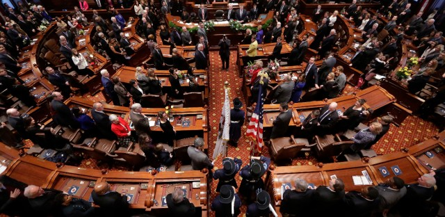 Politicians gather in the Senate chambers at the Illinois State Capitol in Springfield on Jan. 14, 2015.