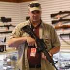 "Shop owner Jeff Binkley displays an AR-15 ""Sport"" rifle at Sarge's Sidearms on Sept. 29, 2016 near Benson, Ariz."