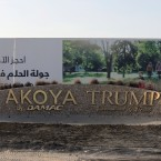 An advertising billboard is seen at the Trump International Golf Club's main entrance in Dubai, United Arab Emirates, Wednesday, Jan. 18, 2017. Security experts warn that businesses around the world bearing U.S. President Donald Trump's name face an increased risk now that the businessman is in the White House. (AP Photo/Kamran Jebreili)